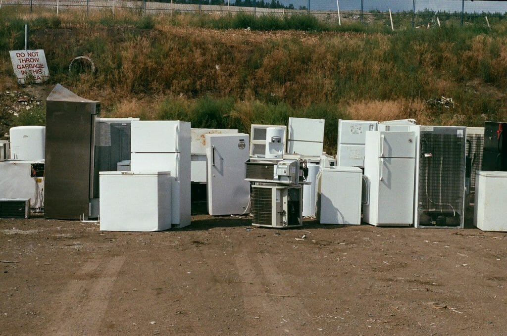 Fridges lined up at a landfill