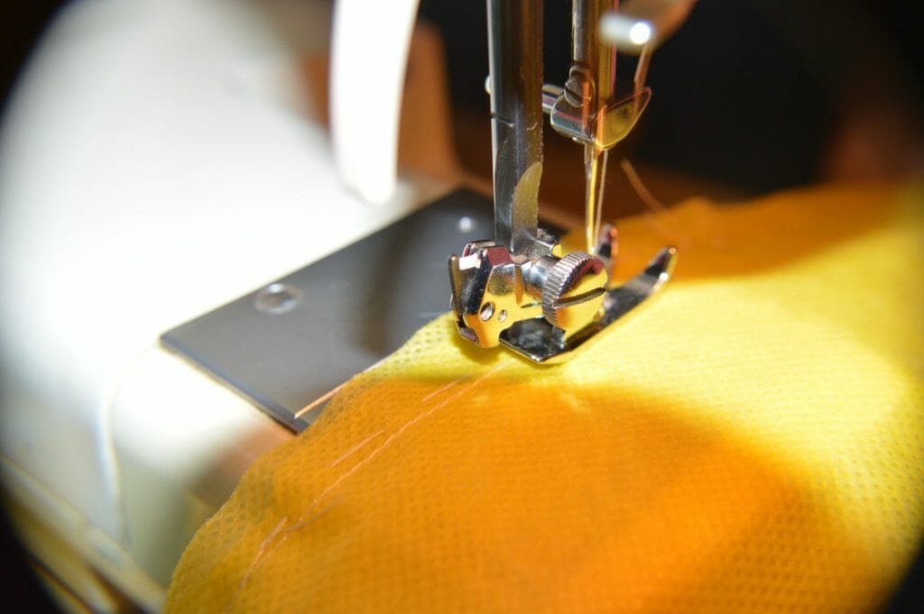 Repairing old clothes with a sewing machine