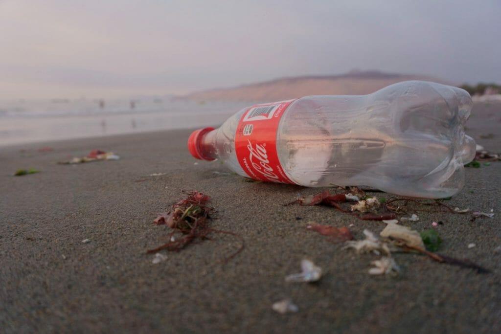 Coca Cola bottle on the beach