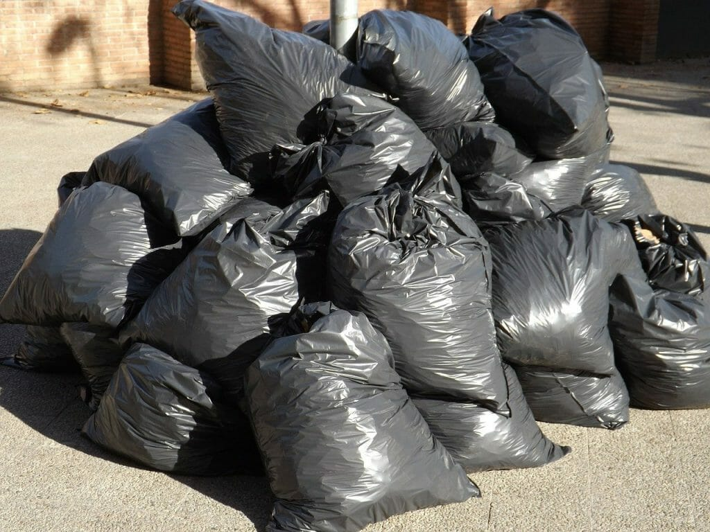Rubbish in black bags piled up after a spring clean