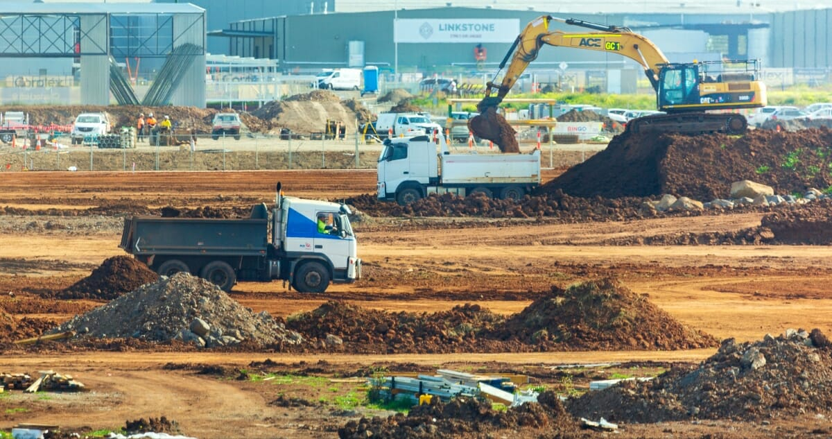 Construction waste in piles onsite