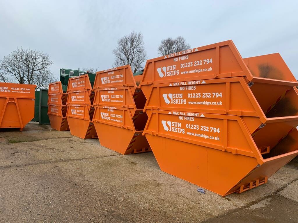 Skips for hire in a stack