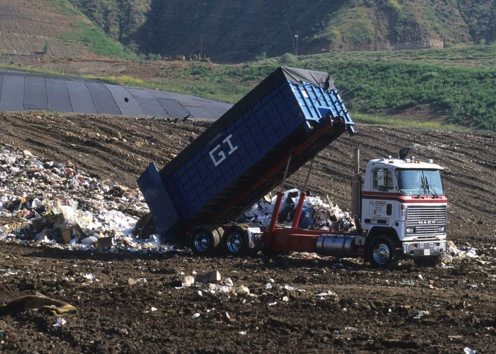 Lorry dumping waste in the landfill