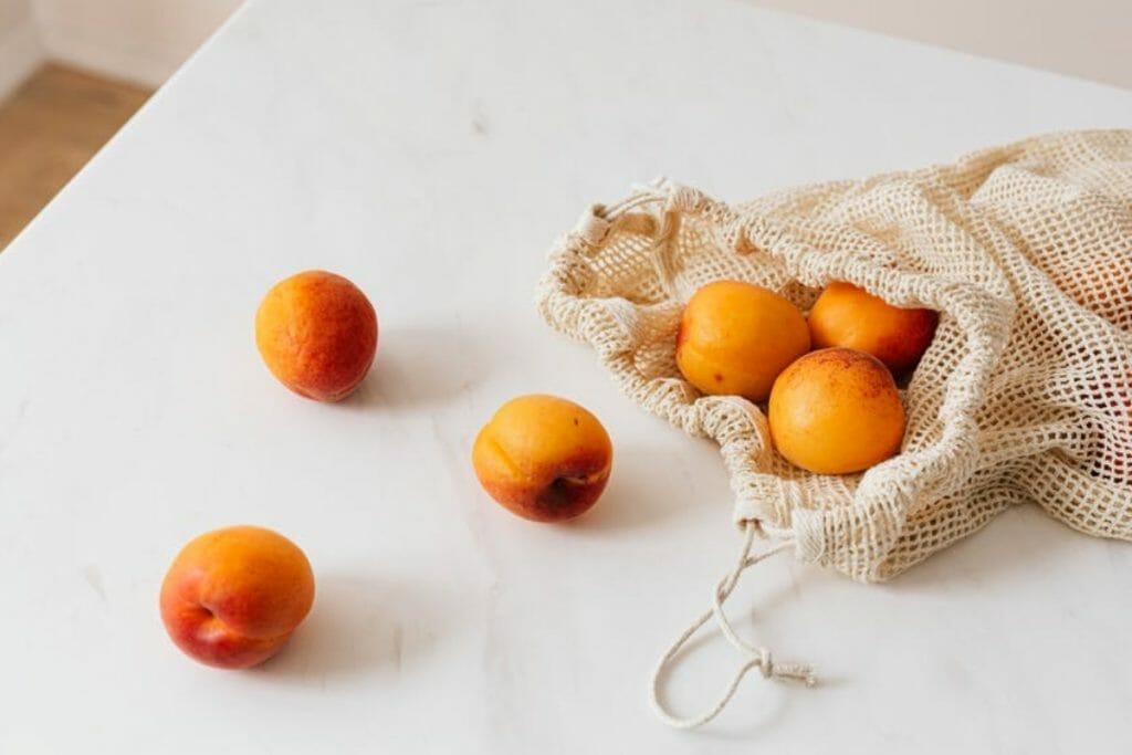 Oranges in a reusable bag