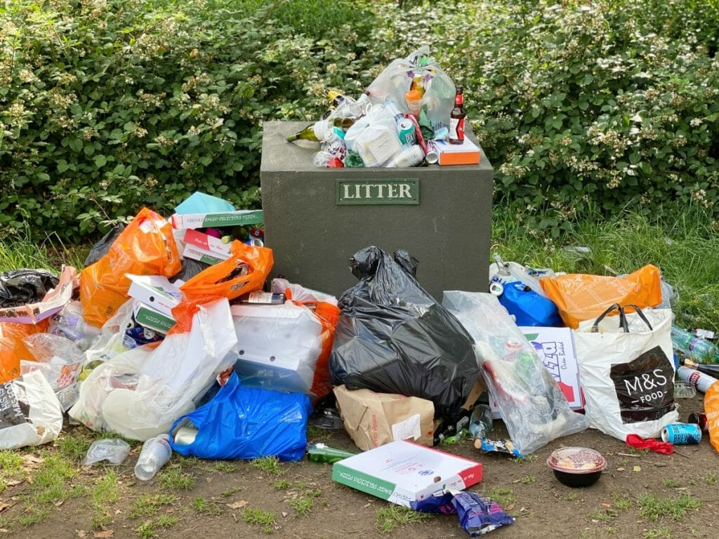 Overflowing litter bin