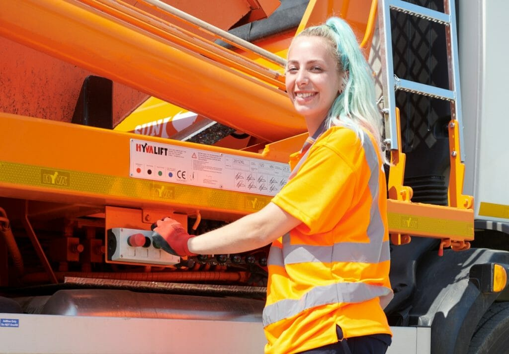 Sophie Marshall operating a skip lorry
